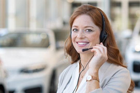 Saleswoman at call center of car dealership