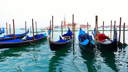 Türaufkleber Gondeln Moored or docked gondolas near the Saint Mark Square with San Giorgio di Maggiore church