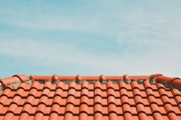 tile roof on the background of the bare sky. copy space for your text