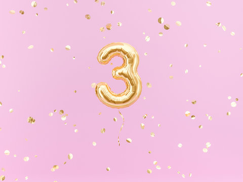 Three year birthday. Number 3 flying foil balloon on pink. Three-year anniversary gold confetti background. 3d rendering
