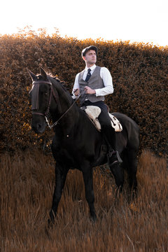 Classic man riding a horse in an autumnal landscape