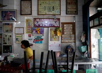 A picture of Thailand's King Maha Vajiralongkorn is seen on a calendar at a restaurant in Bangkok