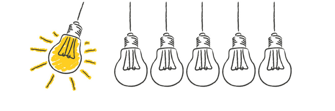 light bulb drawn on whiteboard concept idea