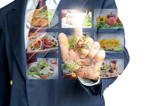 Businessman hand making selection of food menu with digital touch screen
