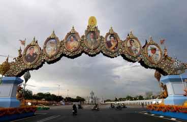 Thailand's King family portrait photos are seen near the Grand Palace in Bangkok
