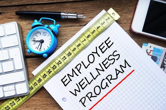 Employee wellness program written on personal agenda at the office
