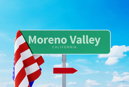 Moreno Valley – California. Road or Town Sign. Flag of the united states. Blue Sky. Red arrow shows the direction in the city
