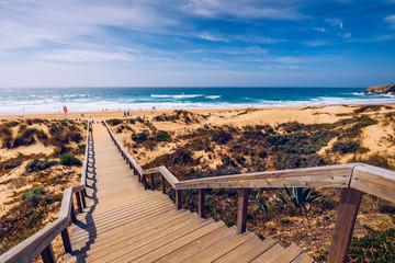 View of the Monte Clerigo beach on the western coastline of Portugal, Algarve. Stairs to beach Praia Monte Clerigo near Aljezur, Costa Vicentina, Portugal, Europe. Wall mural