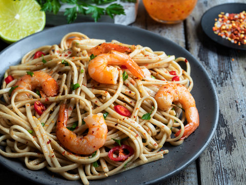 noodles pasta with shrimp , spice , on the plate. Closeup.