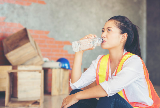 Female engineers are drinking water.