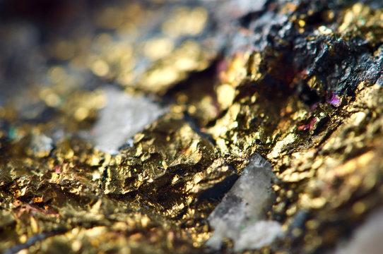 Golden background. Gold nugget. Macro