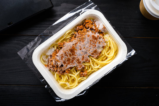 office lunch, frozen spaghetti bolognese on the table