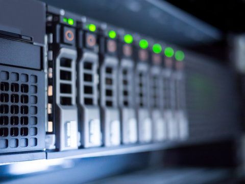 Blurred background of storage server LED status in data center server room