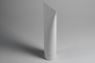 white cosmetic tube for creams
