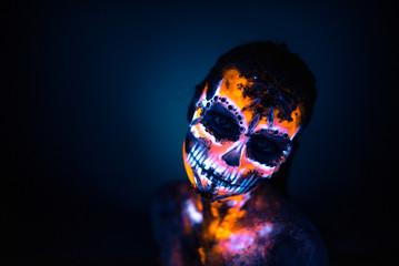 Girl's face painted UV skull