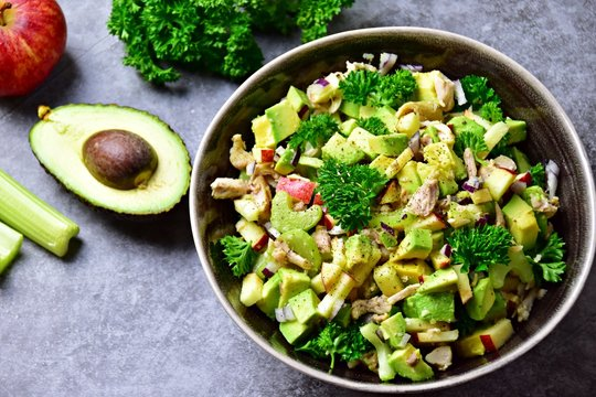 Avocado, apple and chicken salad. Paleo and keto diet healthy dish