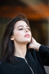 Beautiful smiling young woman wearing black jacket
