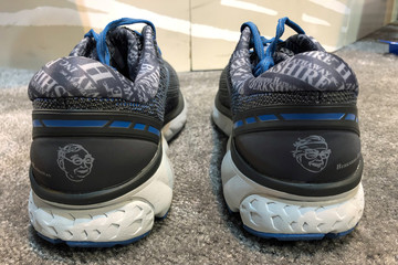 Special edition shoes featuring images of Berkshire Hathaway Chairman Warren Buffett and Vice Chairman Charlie Munger at Berkshire's annual shareholder shopping day in Omaha