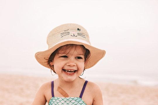 Toddler in sun hat