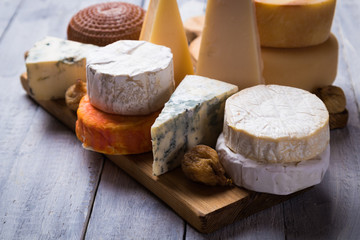 Aged cheese round and slices