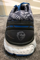 A shoe featuring images of Berkshire Hathaway Vice Chairman at Berkshire's annual shareholder shopping day in Omaha