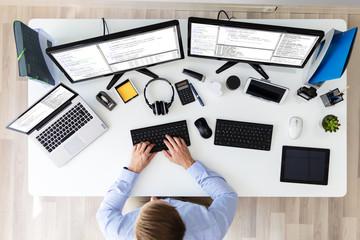 Software developer working in office