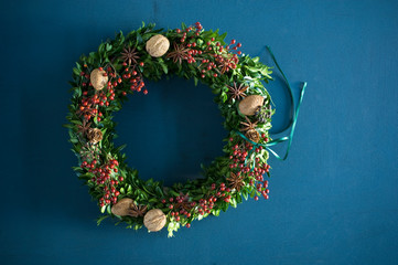 Selfmade Advent wreath, box twigs, rosehip, star anise, walnuts and almonds