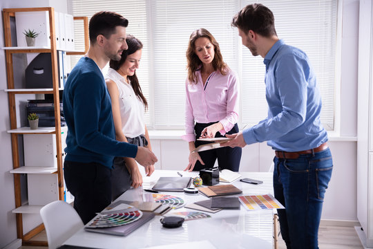 Businesspeople Working Together Choosing Color Palette