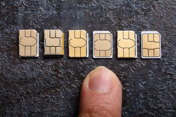 Human's Hand Selecting Sim Cards