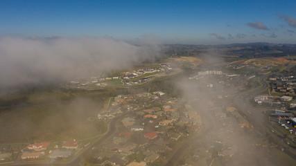 Fog moving through a suburb