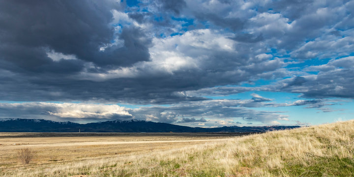 Big sky and foothills in the American west