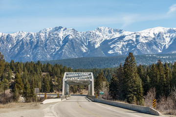 Straight road to the snow mountains in Regional District of East Kootenay Canada.