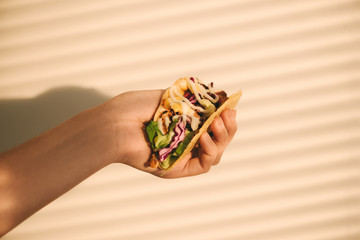 Traditional mexican taco with meat and vegetables. Latin american food. Wall mural