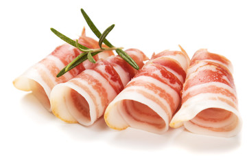 Rolls of pancetta bacon isolated on white