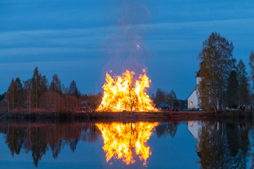 Majestic bonfire by the river celebrating Walpurgis night