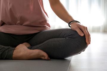 Aluminium Prints Yoga school Woman practicing yoga on floor indoors, closeup