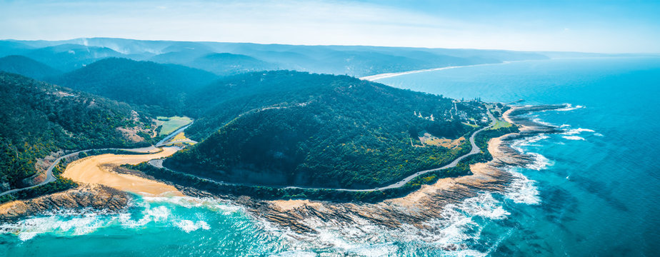 Wide panorama of the famous Great Ocean Road and forested hills in Victoria, Australia
