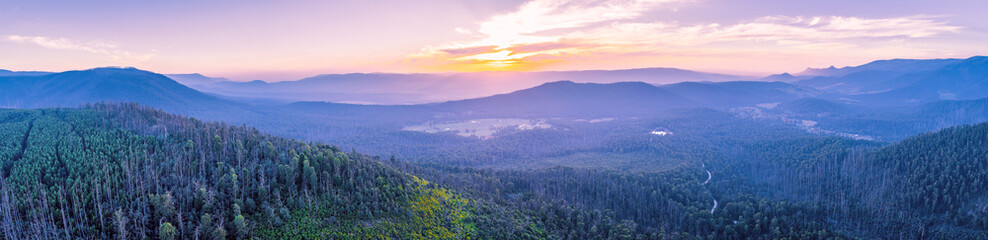Wide aerial panorama of beautiful sunset over mountains in Yarra Ranges National Park, Victoria, Australia Wall mural