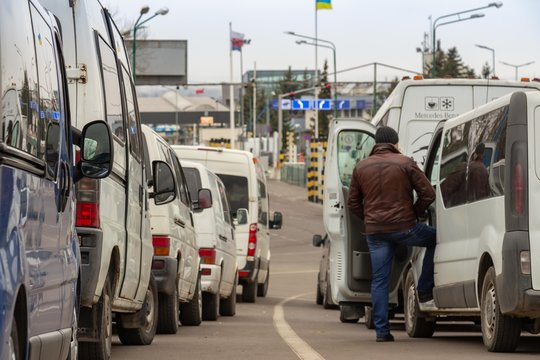 SHEGINI, UKRAINE - March, 2019: Traffic jam at the Shegini-Medyka checkpoint at the Ukrainian-Polish border, vehicles and people waiting for border and customs formalities. Editorial photo