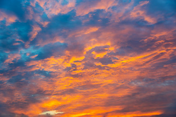 Wall Mural - Dramatic orange sky with clouds at sunset