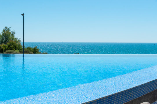 Empty Swimming pool overlooking sea view