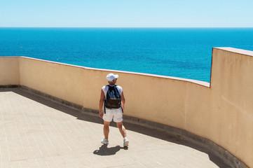 Woman traveler looking at the sea