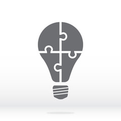 Simple icon light bulb puzzle in gray. Simple icon puzzle  from four pieces on gray background. Soft shadow. Vector illustration EPS10.