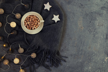 Holidays, winter, christmas, hot drinks concept. Christmas or new year decoration on modern table. Holiday home decor. Toned picture with copy space.