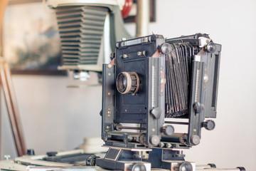 Antique camera on white background, vintage color tone.