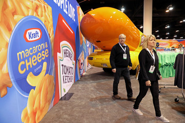 Shareholders shop for discounted products at the Kraft Heinz booth at the annual Berkshire Hathaway shareholder meeting in Omaha