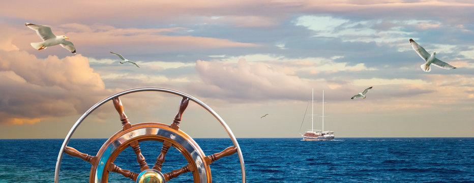 Marine landscape with a captain wheel, seagulls and yacht.