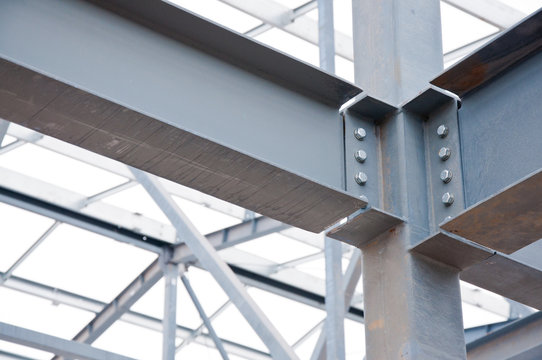 Metal frame of the new building against the sky