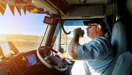Truck drivers big truck right traffic hands holding radio and steering wheel Wall mural