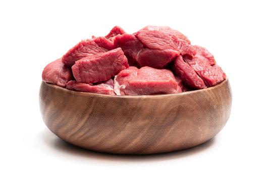 Boneless lamb steak meat in wooden bowl isolated on white